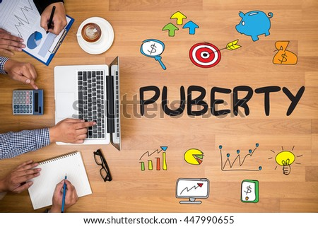 PUBERTY Business team hands at work with financial reports and a laptop - stock photo