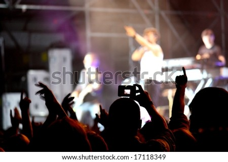 Public at a concert - stock photo