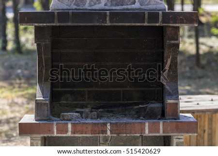Public barbeque fireplace located in a park