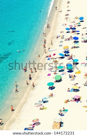 Public beach in Tropea, southern Italy . - stock photo