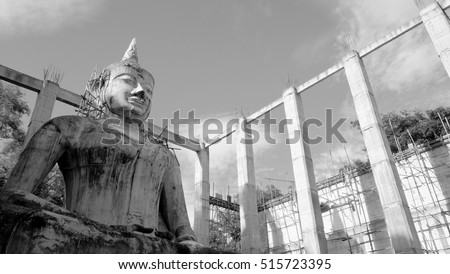 Public buddhist statue, monochrome photo ofconstruction or renovation of Public Buddha statue in Wat Pa Sawang Bun, famous Buddhist temple in Saraburi province of Thailand in strong sunlight day.