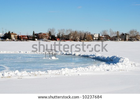 public hockey ring on frozen river in winter, calgary - stock photo