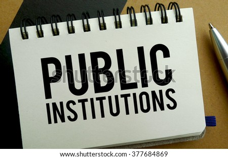 Public institutions memo written on a notebook with pen