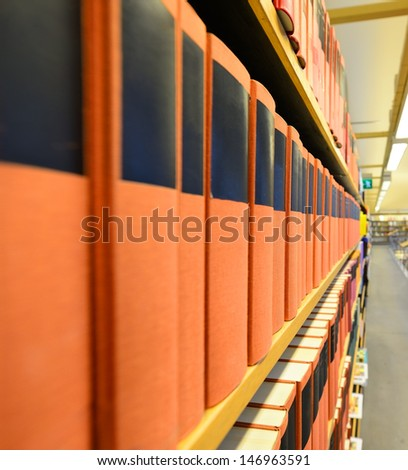 Public library, blurred bright background - stock photo