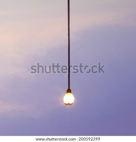 Public lighting in the evening the sky turned dark. - stock photo