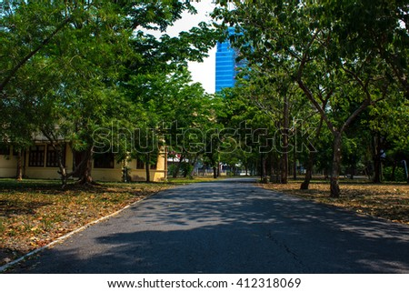 public park in town landscape view background - stock photo