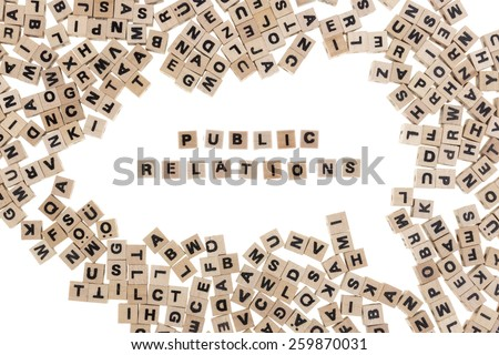 public relations framed by small wooden cubes with letters isolated on white background - stock photo