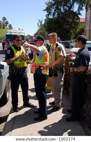 Public safety officials giving directions - stock photo