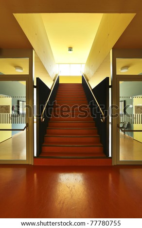 public school, red staircase, interior hall
