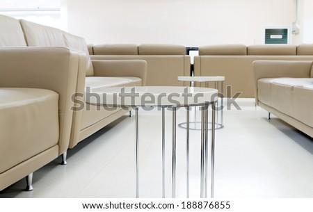 Public Seat on White Floor - stock photo