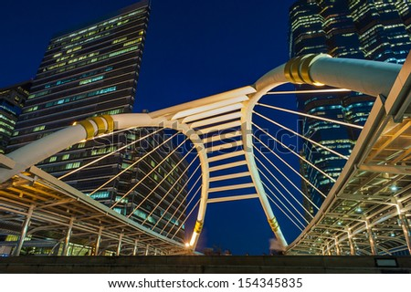 public skywalk at bangkok downtown square night in business zone - stock photo