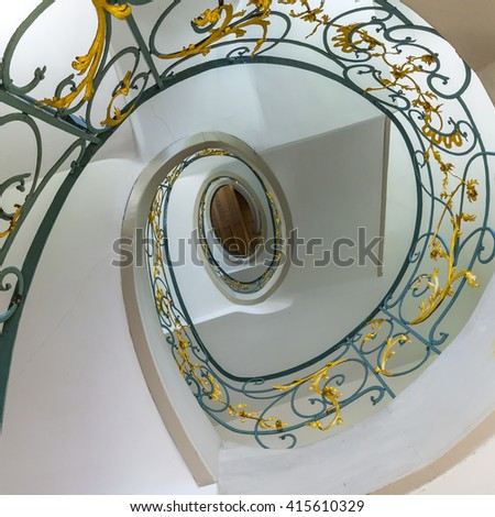public spiral staircase in an old house