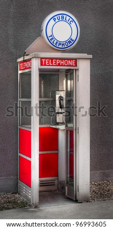 Public Telephone - against wall - stock photo