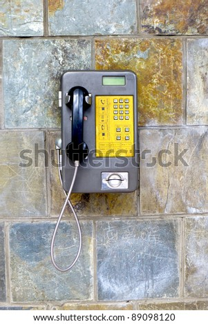 public telephone on wall in a public modern stadium for communication - stock photo