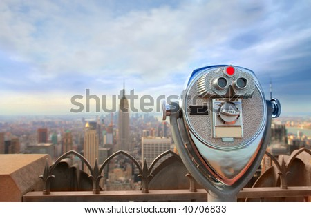 public telescope pointed on Manhattan buildings - stock photo