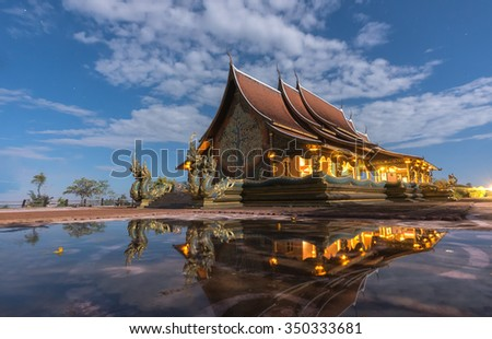 Public temple in Thailand.Shooting reflection at night.Blurred reflection