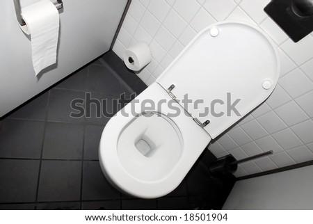 Public toilet in black and white - stock photo