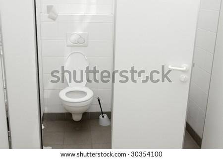 Public toilet with open door - stock photo