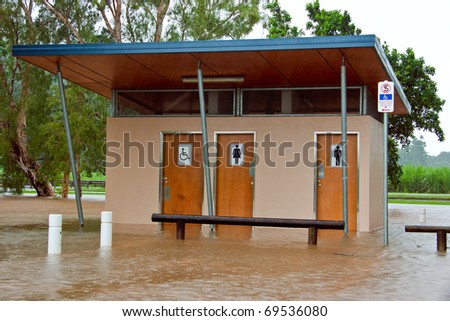 Public toilets and bathrooms flooded after heavy rain and flooding in Queensland, Australia - stock photo