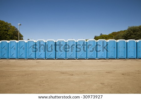 Public toilets in a row - stock photo