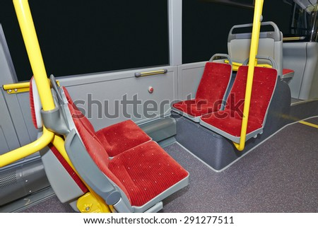 Public Transportation, City Bus Interior with red seats - stock photo