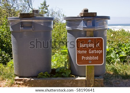 Public trash cans with sign. - stock photo