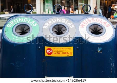 public waste separation in a rubbish skip - stock photo