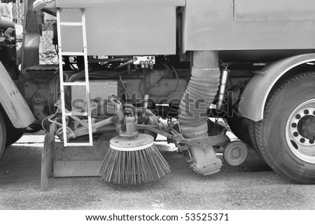 public works street sanitation cleaning machinery truck vacuum sweeper - stock photo