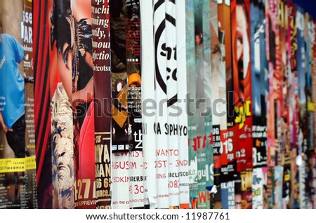 Publicity posters on a street wall