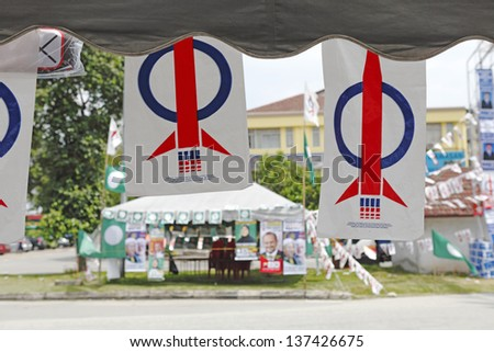 PUCHONG, MALAYSIA - MAY 4: Political banner of the Democratic Action Party for the Malaysian 13th general election on a campaign canopy on May 4, 2013 in Puchong, Malaysia.