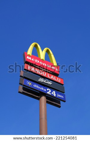 Puchong, Selangor, Malaysia  June 16 2014  McDonalds drive true signage over blue sky in portrait format   Mcdonalds is one of the top and biggest fastfood in Malaysia - stock photo
