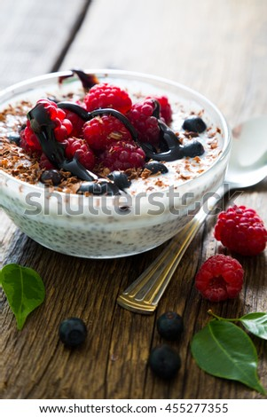 Pudding with chia seeds, fresh berries and chocolate