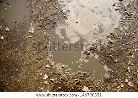 Puddle and mud with tire track texture - stock photo