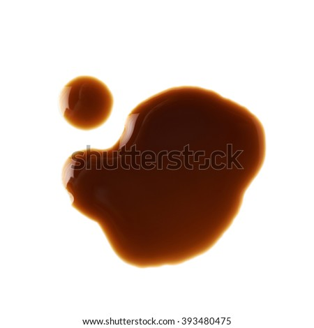 Puddle of soy sauce isolated - stock photo