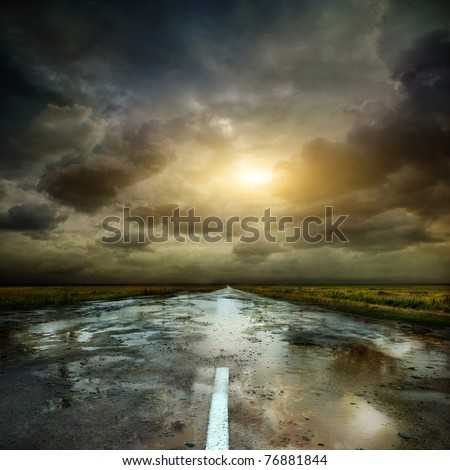 Puddles on a rural road - stock photo