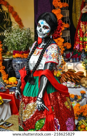 Puebla, Mexico - October 31st, 2013 : Woman disguised for Dia de los Muertos - stock photo