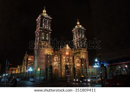 Puebla Roman Catholic colonial illuminated Cathedral at night - consecrated in 1649. It is a major landmark in the city - stock photo