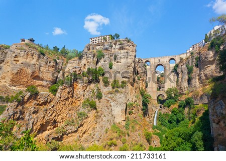 Puente Nuevo (new bridge) and houses on the edge of an abyss in the city Rhonda, Spain - stock photo