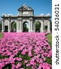 Puerta de Alcala with flowers in foreground, Madrid, Spain - stock photo