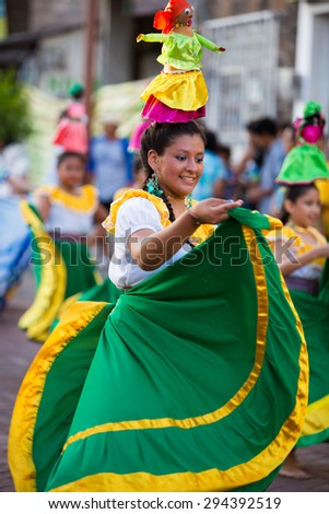 PUERTO AYORA, GALAPAGOS, FEBRUARY 13: Unidentified woman with traditional costume dancing in the street of Puerto Ayora during the official carnaval on Santa Cruz Island. Ecuador 2015. - stock photo