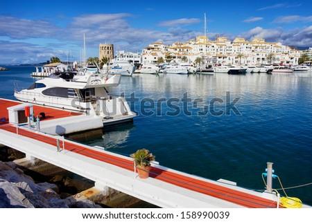 Puerto Banus marina on Costa del Sol, near Marbella in southern Spain, Andalucia region, Malaga province. - stock photo