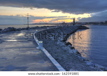 Puerto Banus seafront at sunset. Puerto Bano is an exclusivist port from Costa del Sol, surrounded by luxury restaurants and stores. It is of the largest entertainment centres in the Costa del Sol. - stock photo