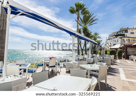 Puerto Banus, Spain - August 15, 2015: Bar where you can drink watching the sea in Puerto Banus, Marbella. - stock photo