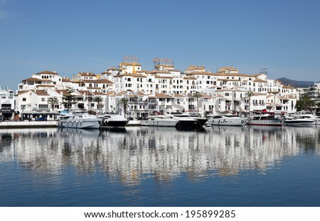 PUERTO BANUS, SPAIN - MAY 22: Luxury yachts and motor boats in the marina. May 22nd 2012 in Marbella, Costa del Sol, Andalusia, Spain - stock photo