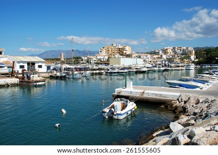 PUERTO CABOPINO, SPAIN - JUNE 7, 2009 - Boats in the harbour with apartment blocks to the rear, Puerto Cabopino, Marbella, Costa del Sol, Malaga Province, Andalucia, Spain, June 7, 2009. - stock photo