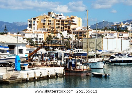 PUERTO CABOPINO, SPAIN - JUNE 7, 2009 - View of the harbour with apartment blocks to the rear, Puerto Cabopino, Marbella, Costa del Sol, Malaga Province, Andalucia, Spain, June 7, 2009. - stock photo