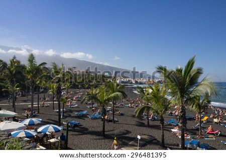 PUERTO DE LA CRUZ, TENERIFE, CANARY ISLANDS - JANUARY 12, 2014: The coast of Atlantic ocean in Puerto De La Cruz, one of the most popular touristic towns, Canary islands, Spain - stock photo