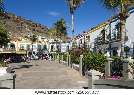 PUERTO DE MOGAN, GRAN CANARIA, CANARY ISLANDS - JANUARY 04, 2014: Pedestrian alley in the harbor area of Puerto de Mogan, a small fishing port and resort on Gran Canaria Island, Spain - stock photo