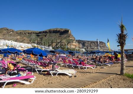 PUERTO DE MOGAN, GRAN CANARIA, CANARY ISLANDS - JANUARY 04, 2014: Quay with shops and restaurants in Puerto de Mogan, a small fishing port and resort on Gran Canaria Island, Spain - stock photo