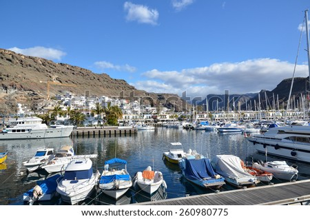 PUERTO DE MOGAN, SPAIN - FEBRUARY 13; View at the marina in Puerto de Mogan, Gran Canaria, Spain. Popular travel location and harbor. Photo taken on February 13, 2015 in Puerto de Mogan, Gran Canaria, - stock photo